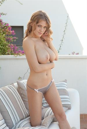 Viola Bailey gets naked on a patio