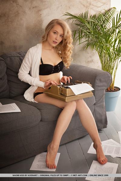 Naomi Kiss in  Samai  for MetArt - Alluring Naomi Kiss strips on the couch as she types her paper.