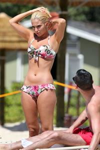 Tulisa Contostavlos in a bikini on the beach in Honolulu July 31, 2012