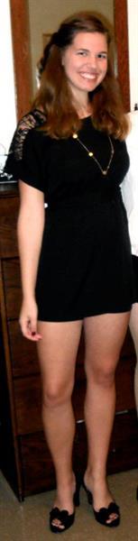Showing off her great legs in a little black dress