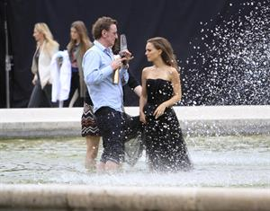 Natalie Portman modeling for a Miss Dior campaign photo shoot in the gardens of the Palais Royal in Paris 6/26/12