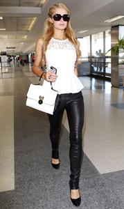 Paris Hilton In leather pants, arriving at LAX Airport in Los Angeles - September 6, 2013