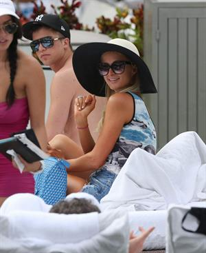 Paris Hilton spends the day in and out of the pool in Miami December 8, 2012