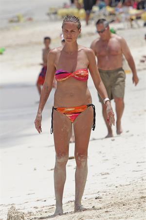 Heidi Klum wearing a bikini on a beach in the Bahamas on July 6, 2013