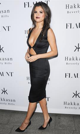 Selena Gomez showing off a ton of cleavage at Flaunt Magazine Release Party in Beverly Hills - Los Angeles - November 7, 2013