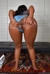 Monique Symone in blue lace lingerie