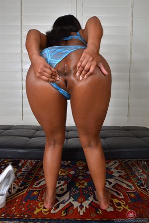 Monique Symone in blue lace lingerie