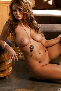 Leanna Decker posing  and stripping