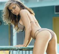 Carmen Electra in lingerie - ass