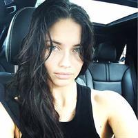 Adriana Lima taking a selfie