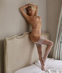 Caroline Vreeland sexy lingerie photo shoot showing her sexy ass and cleavage with her famous big boobs in just a bra and panties.