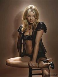 Rebecca Romijn in lingerie