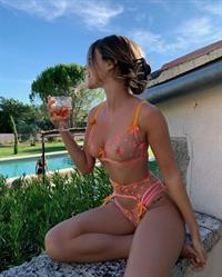 Mathilde Tantot sitting outside in her backyard drinking wearing sexy see through lingerie showing off her big tits in matching bra and panties.