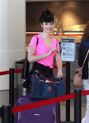 Krysten Ritter - Prepares to leave LAX in Los Angeles, California - June 8, 2012