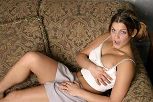 Sara Sexton getting naked on a couch